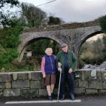 Michael and Mary O Shea sitting on Curradubh Bridge, Camp